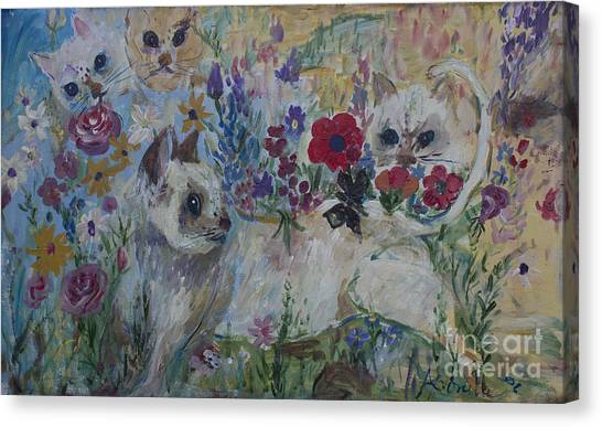 Kittens In Wildflowers Canvas Print