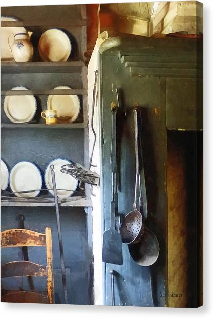 Ladles And Spatula In Kitchen Canvas Print by Susan Savad