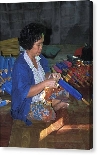 Lady Makes Umbrellas At A Factory Near Chaing Mai Canvas Print by Richard Berry