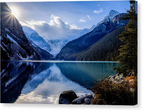 Lake Louise With Sunstar Canvas Print
