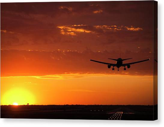 Business-travel Canvas Print - Landing Into The Sunset by Andrew Soundarajan