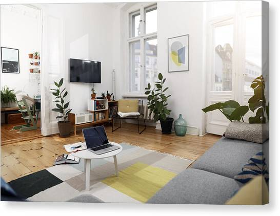 Laptop On A Coffee Table In A Modernly Furnished Flat Canvas Print by Westend61