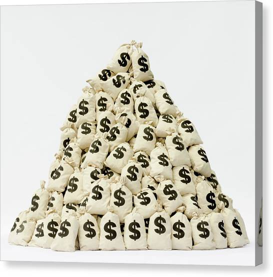 Large Pile Of Money Bags In A Pyramid Canvas Print by Pm Images