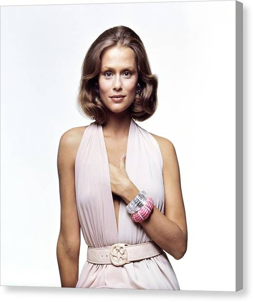 Lauren Hutton Wearing A Galanos Dress Canvas Print by Bert Stern