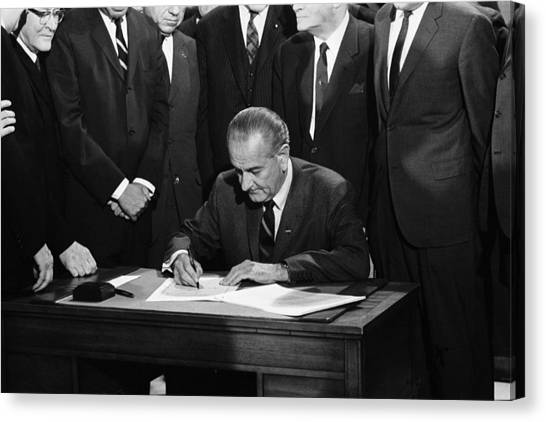 Lyndon Johnson Canvas Print - Lbj Signs Civil Rights Bill by Underwood Archives Warren Leffler