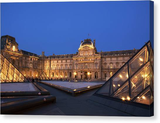 Le Louvre Canvas Print - Le Louvre Palace Buildings And Pyramids by Philippe Widling