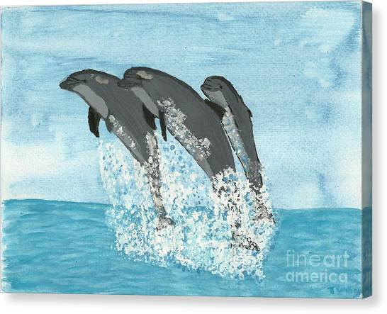 Leaping Dolphins Canvas Print