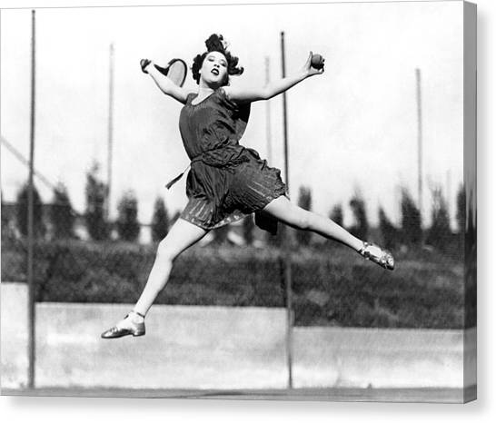 Tennis Racquet Canvas Print - Leaping Tennis Woman by Underwood Archives