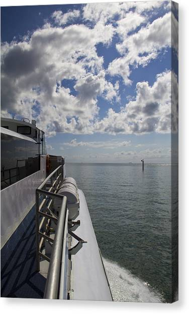 Leaving The Channel Canvas Print by Debbie Cundy