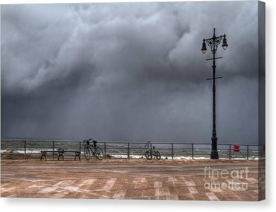 Sandy Beach Canvas Print - Left In The Power Of The Storm by Evelina Kremsdorf