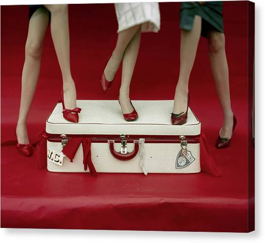 Legs Of Models Standing On A Suitcase Canvas Print by Sante Forlano