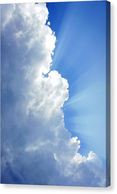 Light Behind The Clouds Canvas Print by Thomas Fouch