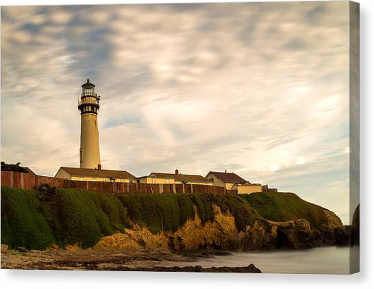 Lighthouse And Clouds Canvas Print