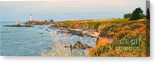 Lighthouse In Summer Canvas Print by Artist and Photographer Laura Wrede