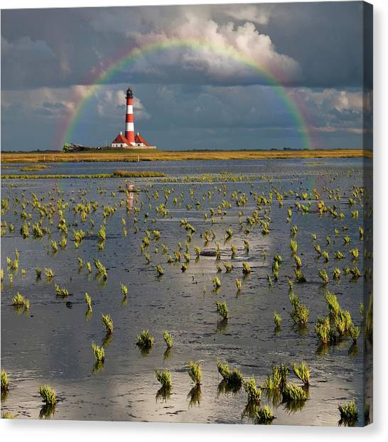 Rainbow Canvas Print - Lighthouse Meets Rainbow by Carsten Meyerdierks