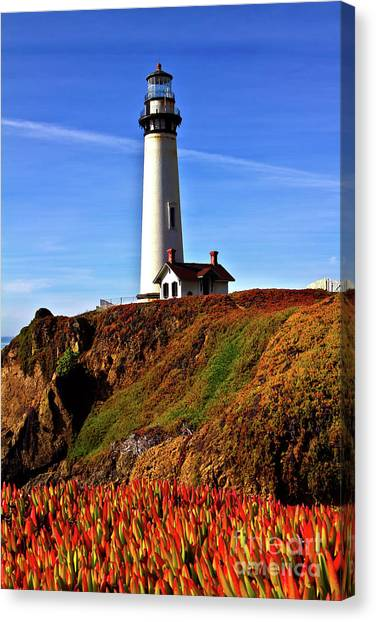 Lighthouse With Red Blooms Canvas Print