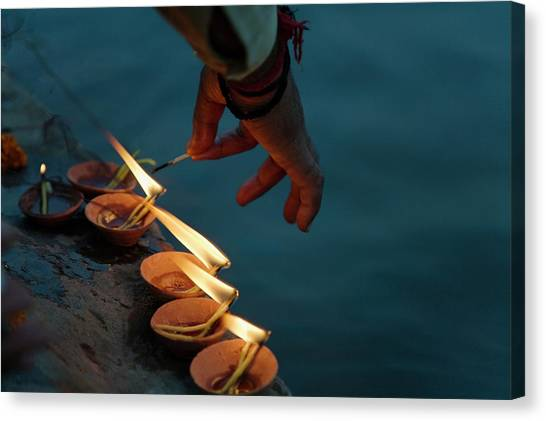 Ganges Canvas Print - Lighting Flower Lamps By The Ganges by Keren Su
