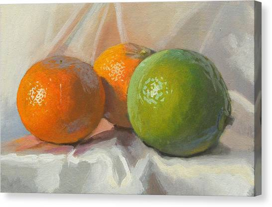 Lime And Clementines Canvas Print by Peter Orrock