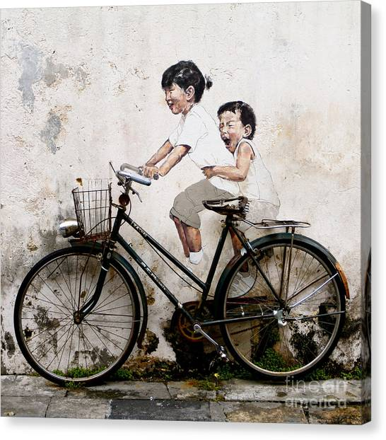 Little Children On A Bicycle Canvas Print by Donald Chen