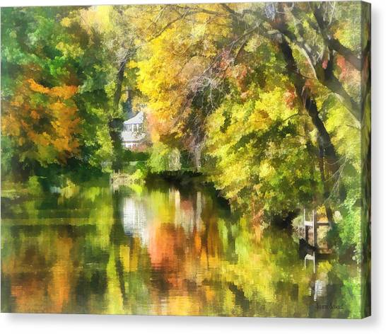 Little House By The Stream In Autumn Canvas Print by Susan Savad