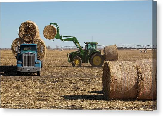 Hay Bales Canvas Print - Loading Bales Of Hay by Jim West
