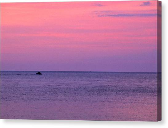 Lobster Boat Under Purple Skies Canvas Print by Jeremy Herman