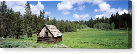 Log Cabin Canvas Print - Log Cabin In A Field, Klamath National by Panoramic Images