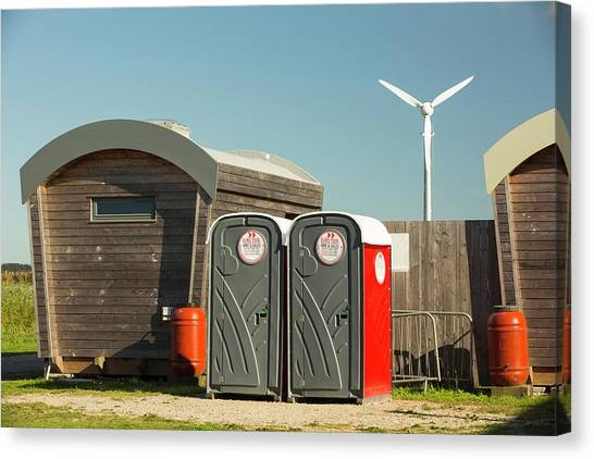 Log Cabin Canvas Print - Log Cabins And A Wind Turbine by Ashley Cooper