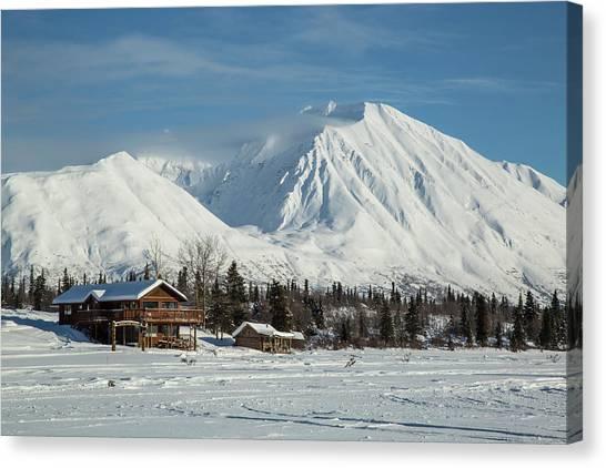 Log Cabin Canvas Print - Log Cabins On Frozen Lake Shore by Matt Andrew