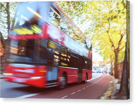 London Red Double Decker Bus Driving At Canvas Print by Pavliha