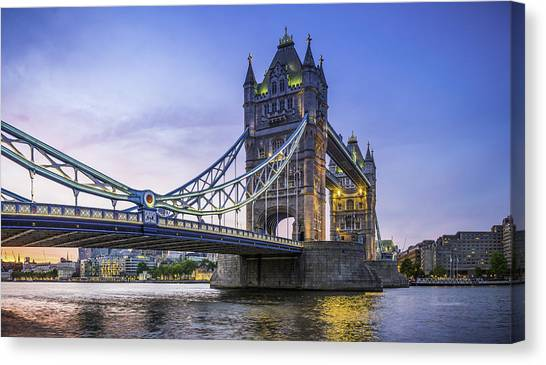London Tower Bridge Illuminated At Sunset Over River Thames Panorama Canvas Print by fotoVoyager