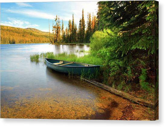 Lone Canoe On Shores Of Upper Payette Canvas Print