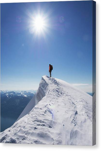 Lone Climber On The Top Of A  Mountain Canvas Print by Buena Vista Images