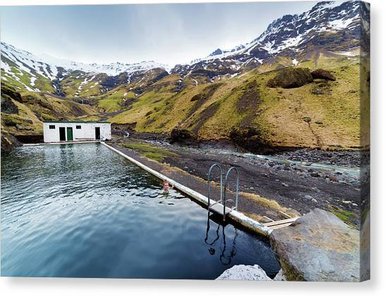 Lone Tourist At Seljavallalaug Pool Canvas Print by Anna Gorin
