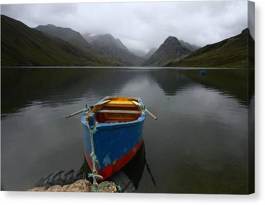 Lonely Boat Canvas Print by Dan Breckwoldt