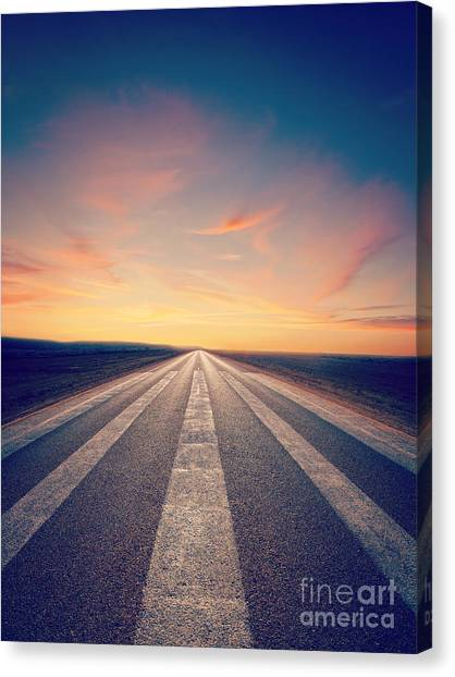 Roads Canvas Print - Lonely Road At Sunset by Colin and Linda McKie