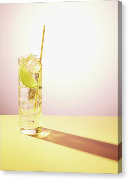 Long Drink In Glass With Lime And Straw Canvas Print