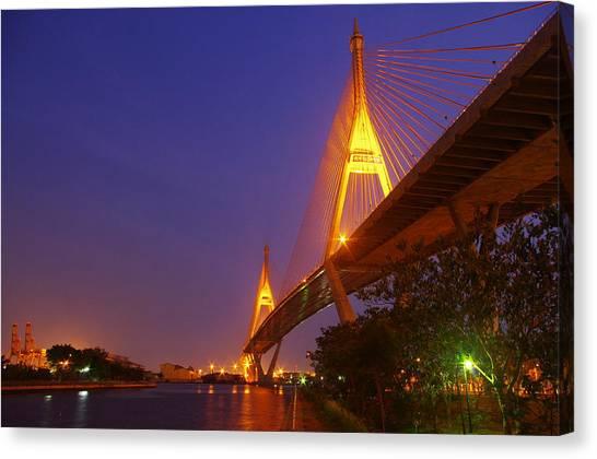 Longest Bridge In Bangkok Canvas Print by Panitsak Kunwong