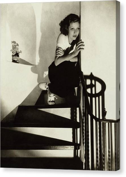 Loretta Young Sitting On A Staircase Canvas Print
