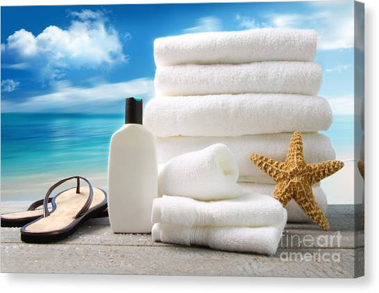Lotion  Towels And Sandals With Ocean Scene Canvas Print