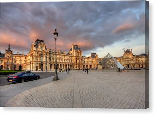 Louvre Museum At Sunset Canvas Print by Ioan Panaite