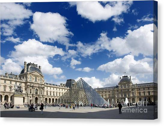 Le Louvre Canvas Print - Louvre Museum. The Pyramid. Paris by Bernard Jaubert