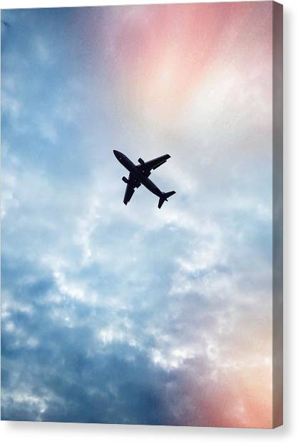 Low Angle View Of Airplane Flying In Canvas Print by Maurice Rivera / Eyeem