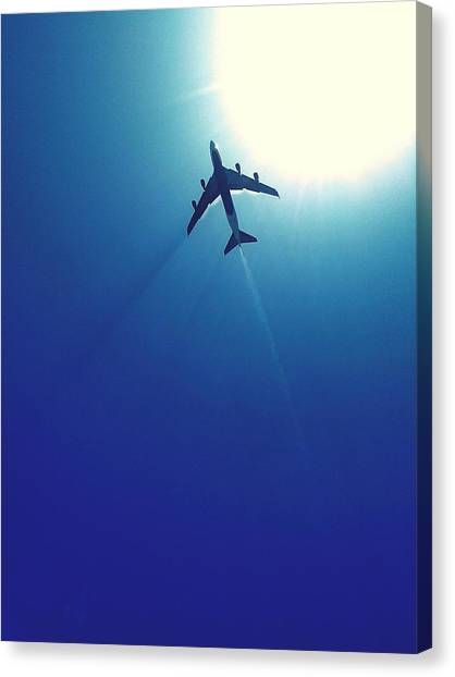 Low Angle View Of Airplane In Flight Canvas Print by Karla Peña / Eyeem
