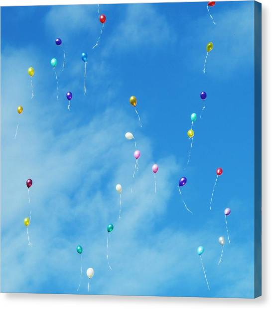 Low Angle View Of Balloons Flying Against Sky Canvas Print by Alexey Ivanov / EyeEm