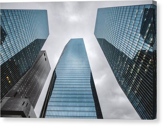 Low Angle View Of Modern Buildings Canvas Print by Oliver Byunggyu Woo / Eyeem