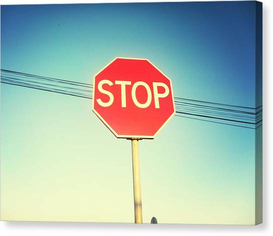 Low Angle View Of Stop Sign Canvas Print by Pedro Venâncio / Eyeem