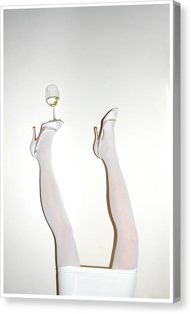 Low Section Of Woman Balancing Wine Canvas Print by Kostis Fokas / Eyeem