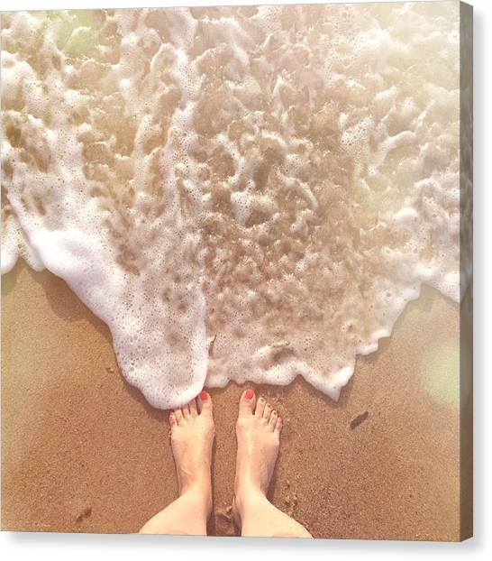 Low Section Of Woman Standing By Surf Canvas Print by Alexandra Ribeiro / Eyeem