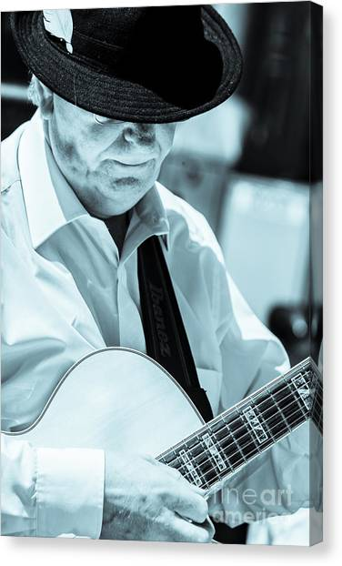 Male In Alpine Hat Playing Guitar Canvas Print